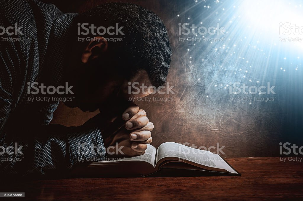Men praying to God stock photo