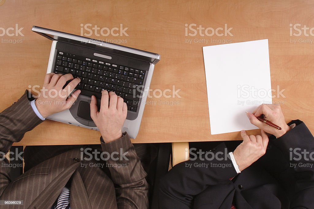 men preparing contract - on laptop and paper 3 - Royalty-free Adult Stock Photo
