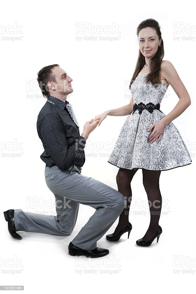 Men proposing marriage to a woman. royalty-free stock photo