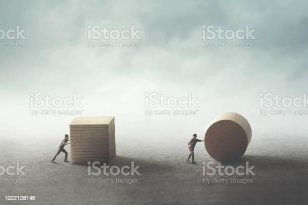 Men pushing different geometric wooden shapes picture id1022128146?b=1&k=6&m=1022128146&s=612x612&h=vzxo9usfncchh7mc2oc4kjhmzbohrbw4b6bbupzikmw=