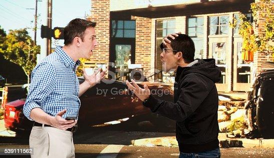 475395935istockphoto Men quarreling in front of car crash 539111562