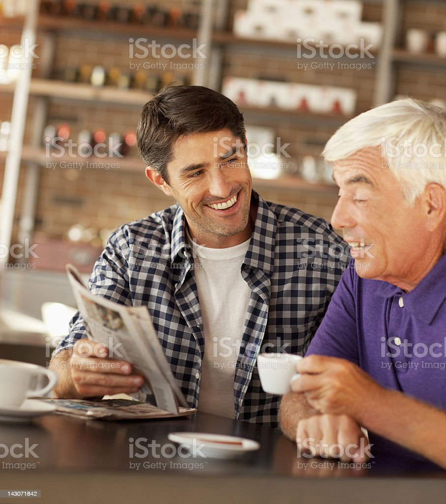 Men reading newspaper in cafe royalty-free stock photo
