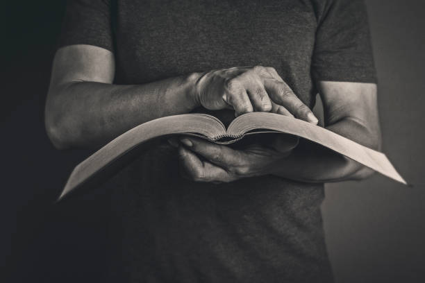 Men reading the Holy Bible stock photo