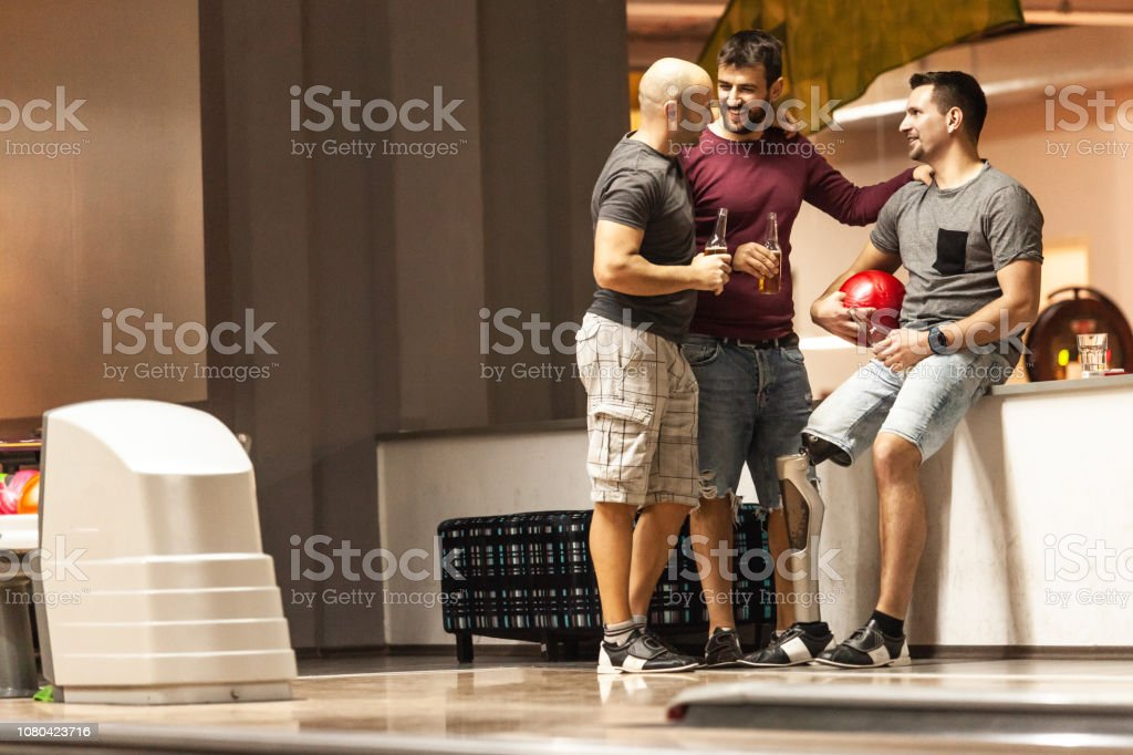 Men relaxing after bowling stock photo