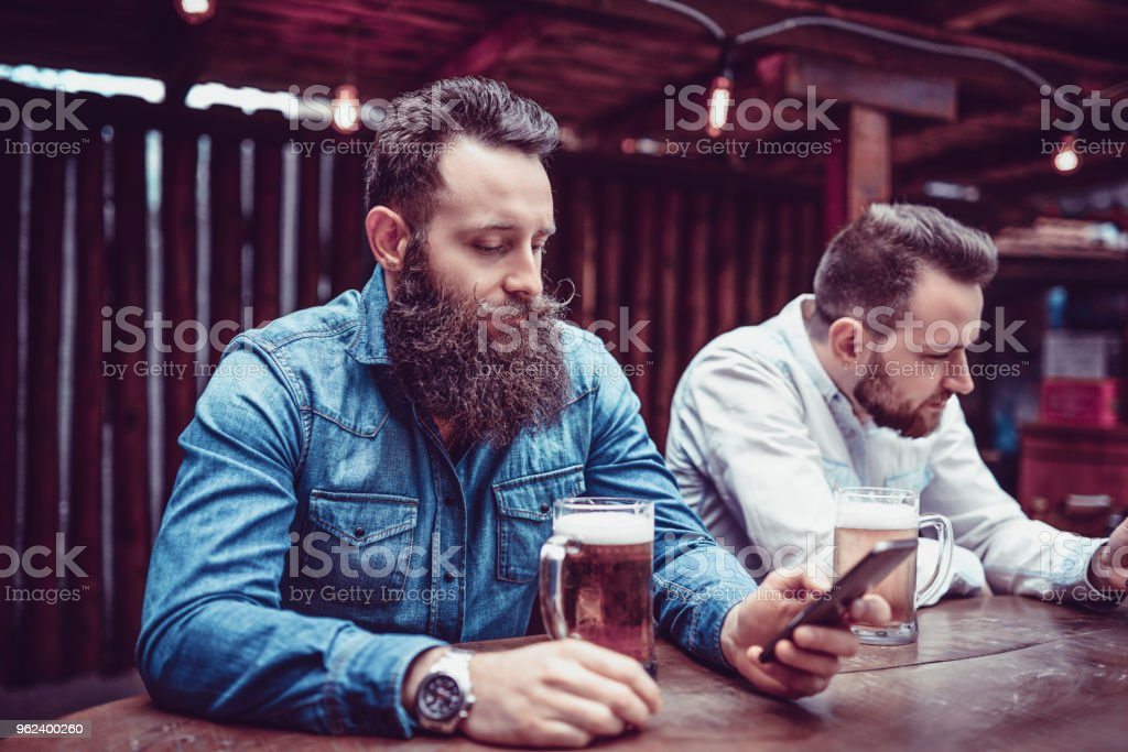 Men Relaxing In Pub After A Work Week stock photo