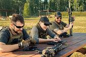 istock Men reloading guns 1269922979