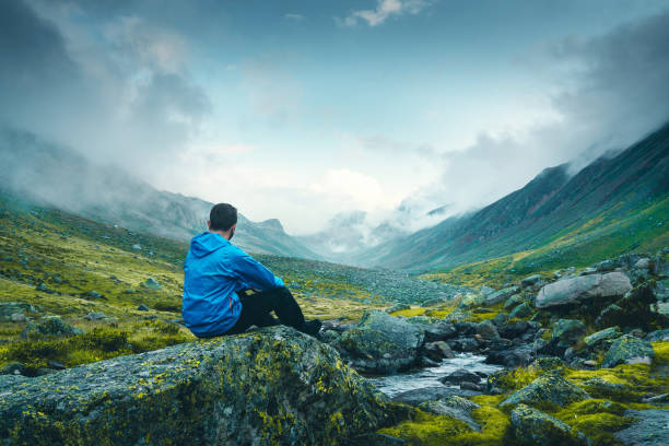 Men resting on the rock Mountain, Man, Water, Motivation, Hiking one man only stock pictures, royalty-free photos & images