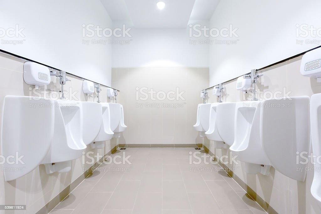 Men restroom inside a shopping mall royalty free