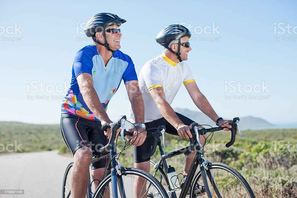 Men riding bicycles in remote area royalty-free stock photo