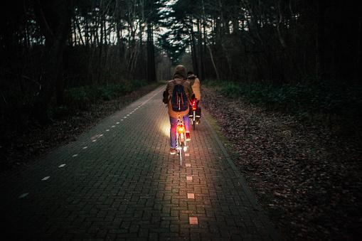 Men riding bike