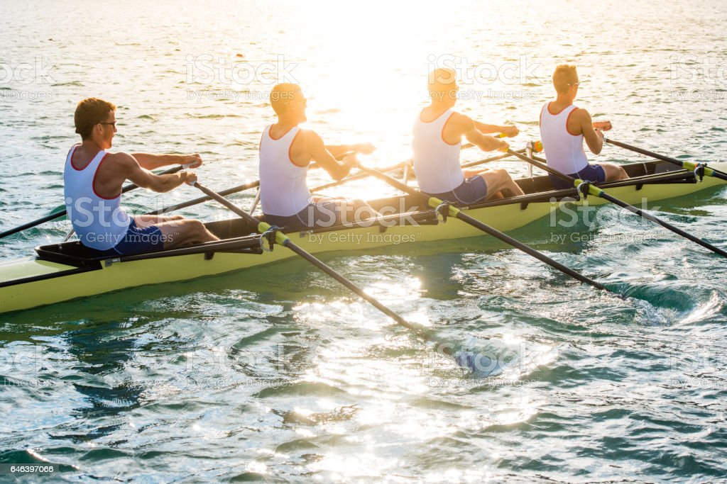 Men rowing boat stock photo