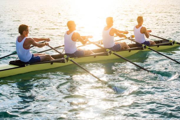 Men rowing boat stock photo