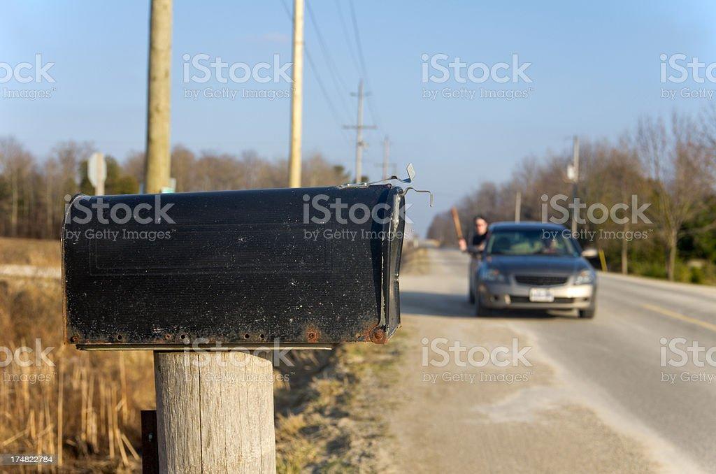 Men ruining mailboxes around their neighbourhood. royalty-free stock photo