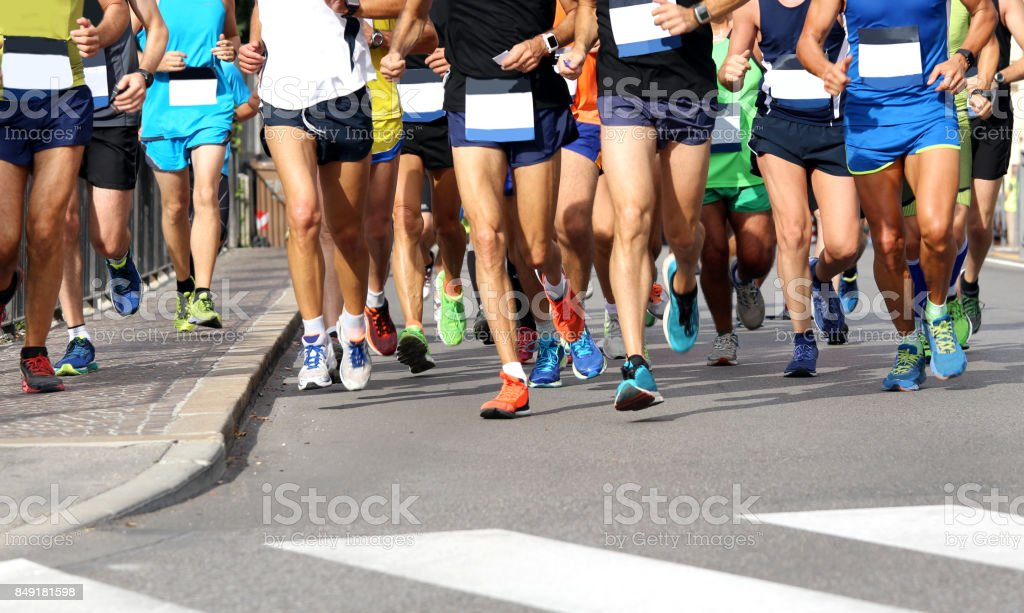 Men run the marathon on the road without logos and brand stock photo
