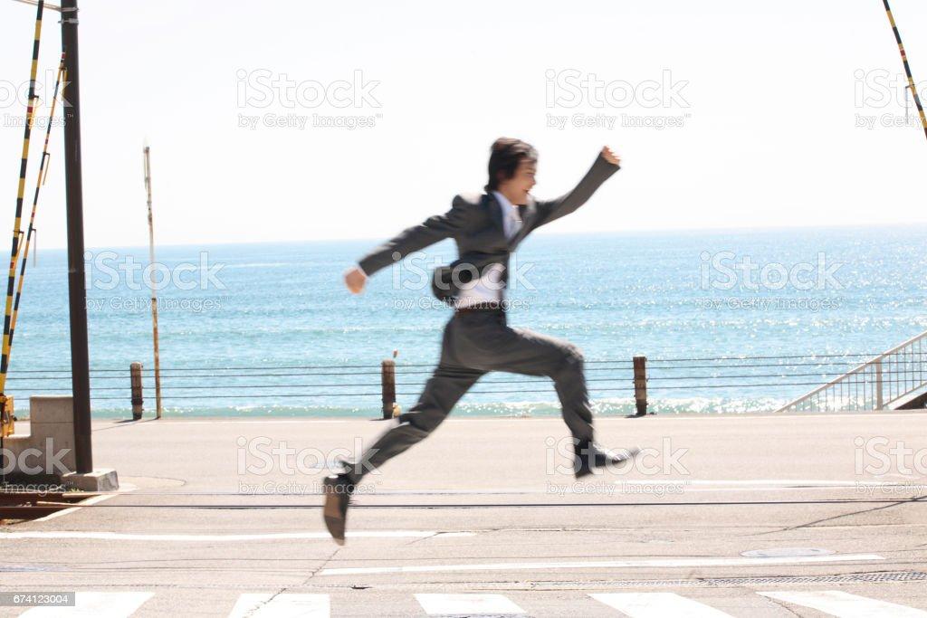 Men run the pedestrian crossing stock photo