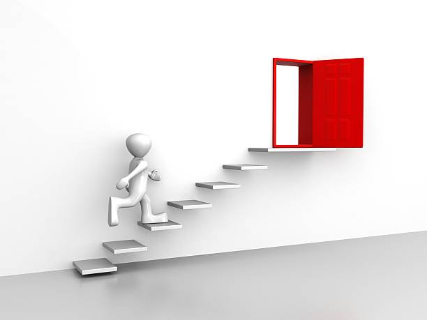 Men running on stair to open door stock photo