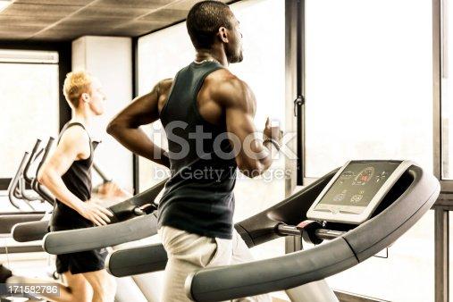1069872470 istock photo Men running on the gym treadmill 171582786