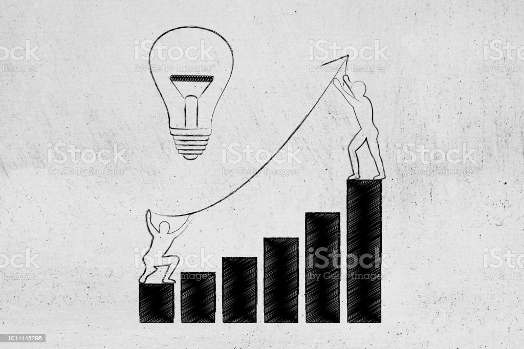 men setting up an arrow up a business growth graph next to lightbulb stock photo