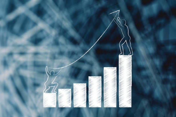 men setting up an arrow up a business growth graph stock photo