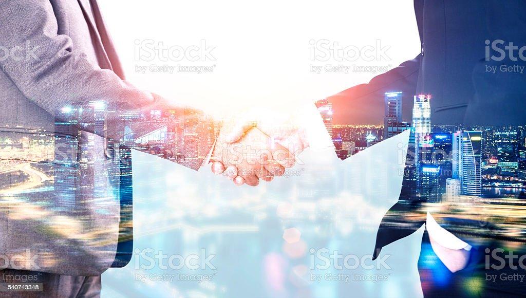 Men shaking hands multiexposure stock photo