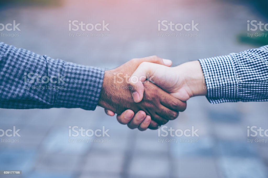 Men shaking hands stock photo