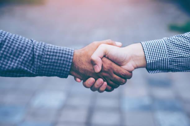 Men shaking hands stock photo
