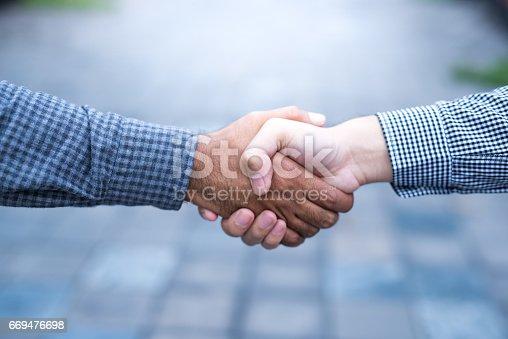 istock Men shaking hands 669476698