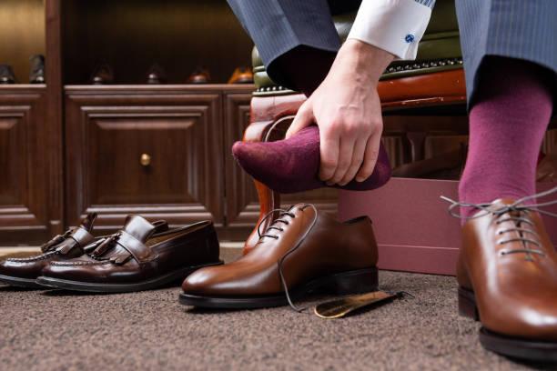 men shoes boutique store - men shoes stock pictures, royalty-free photos & images