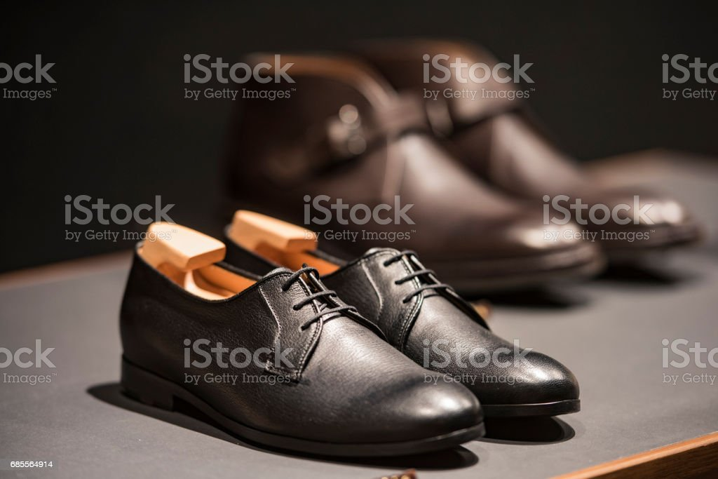 Men shoes in a luxury store in Paris. 免版稅 stock photo