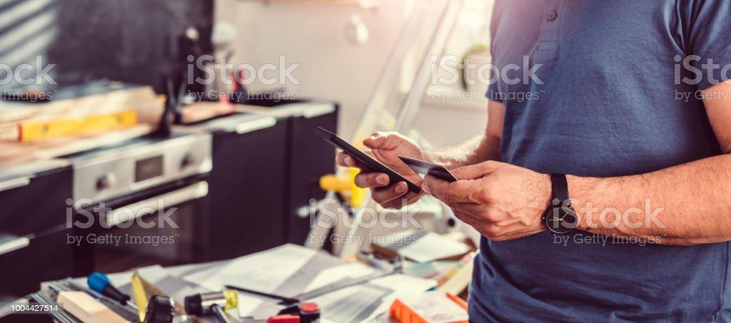 Men shopping construction material online stock photo