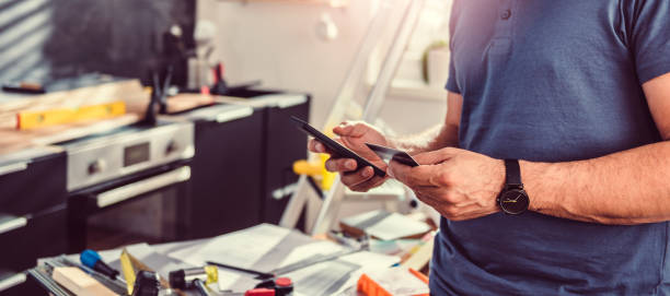 men shopping construction material online - business credit card stock photos and pictures