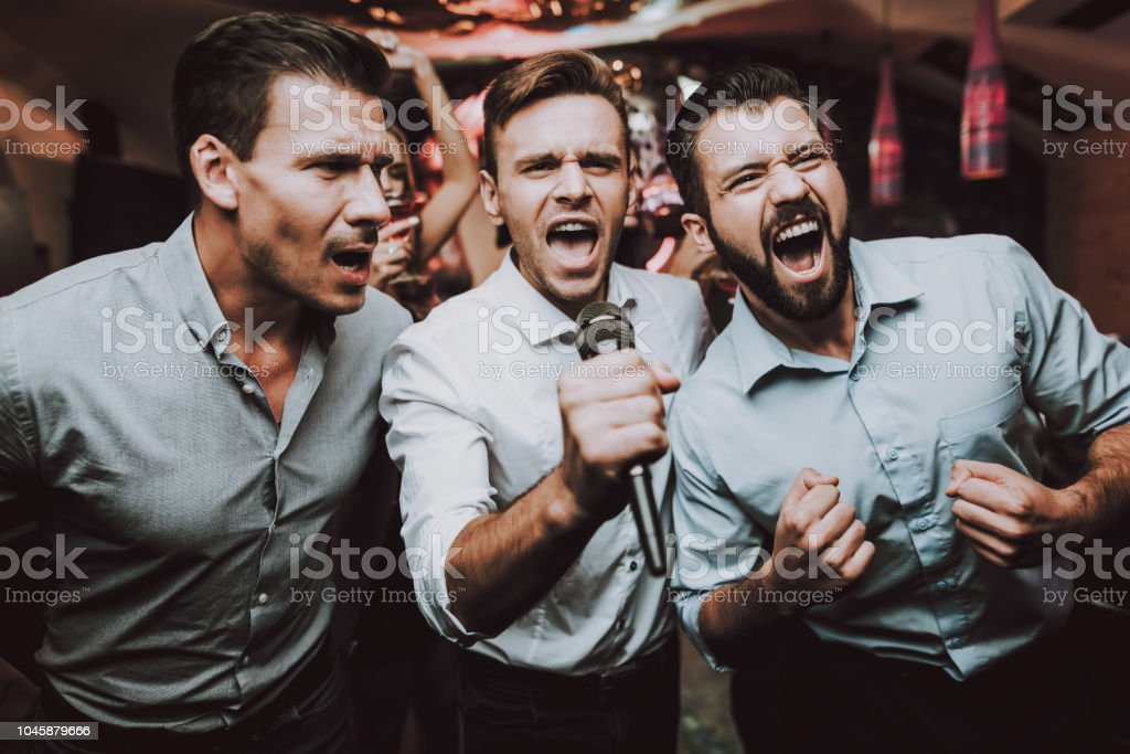 Men Sing. Boys. Great Mood. Young People. Birthday. stock photo