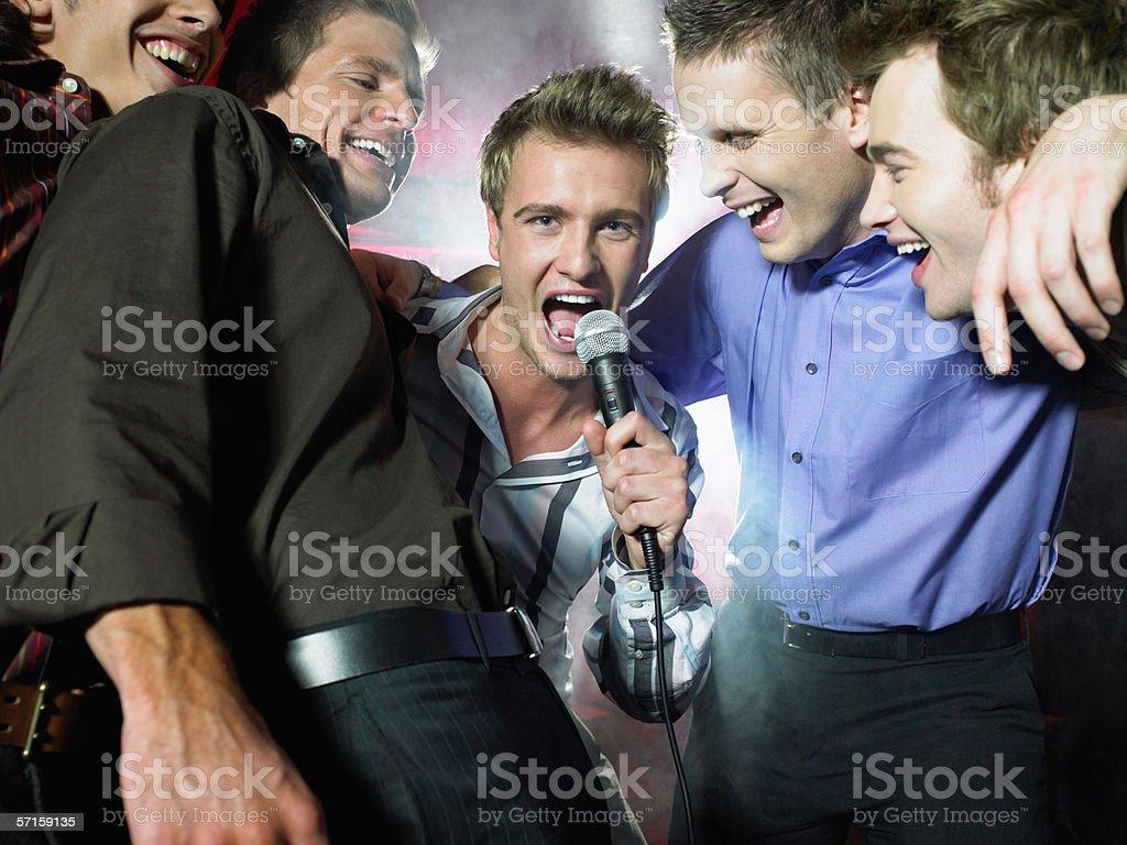Men singing in a bar royalty-free stock photo