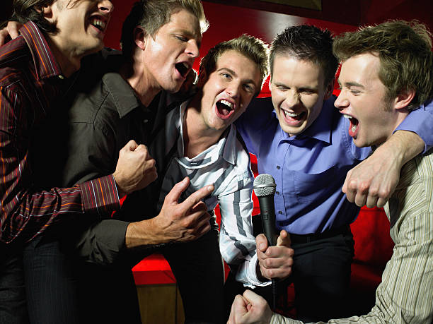 Men singing in a bar stock photo