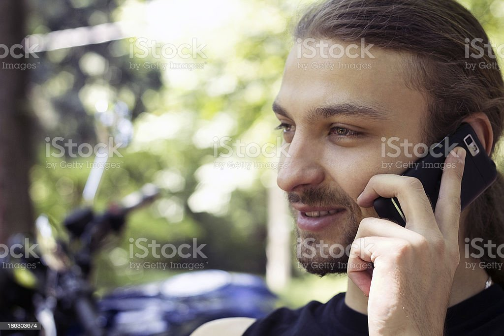 Men smiling while using cellphone royalty-free stock photo