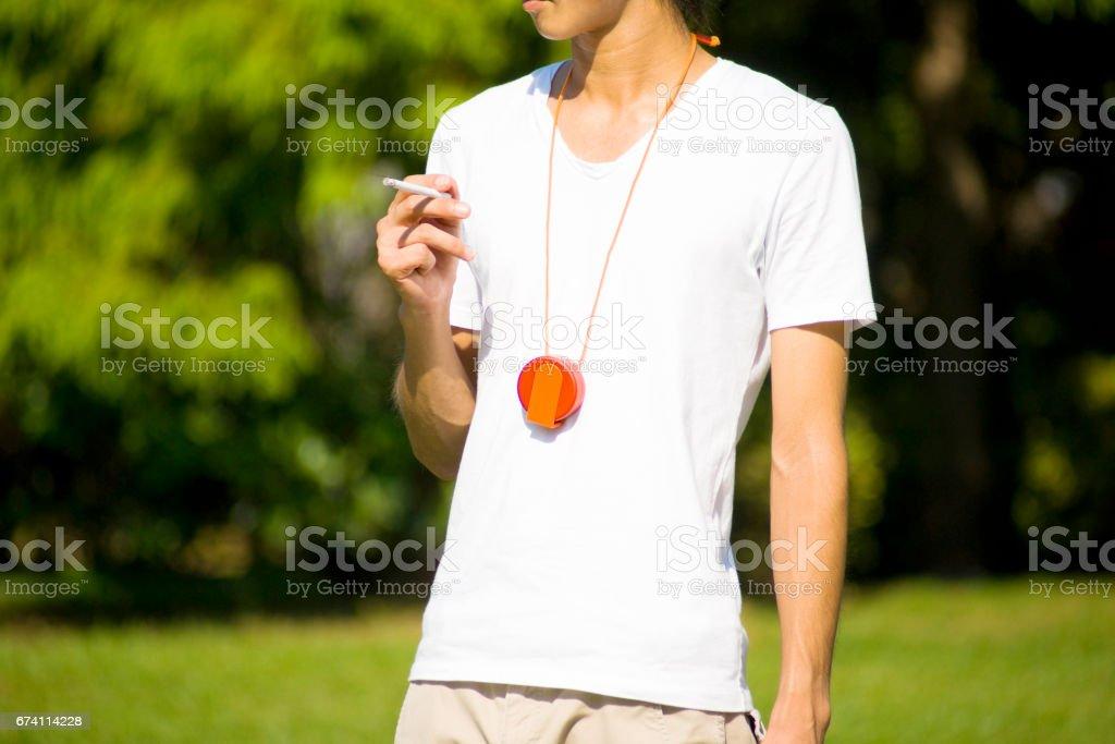Men smoke outside royalty-free stock photo