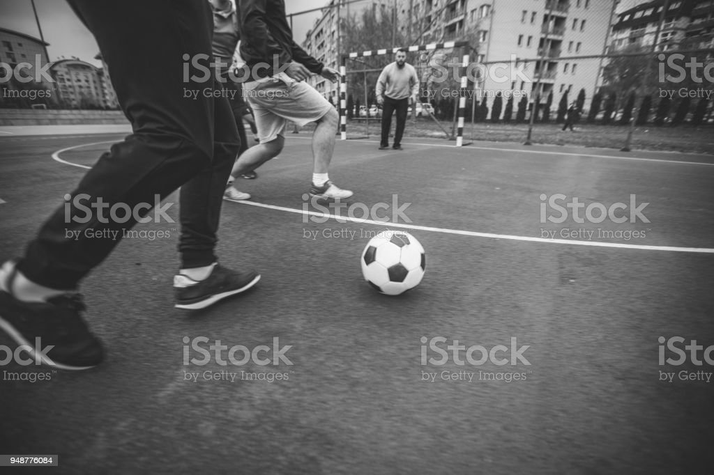 Men soccer game outdoors stock photo