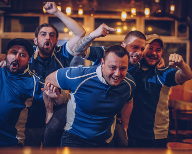 men sport fans in pub - sports championship stock photos and pictures