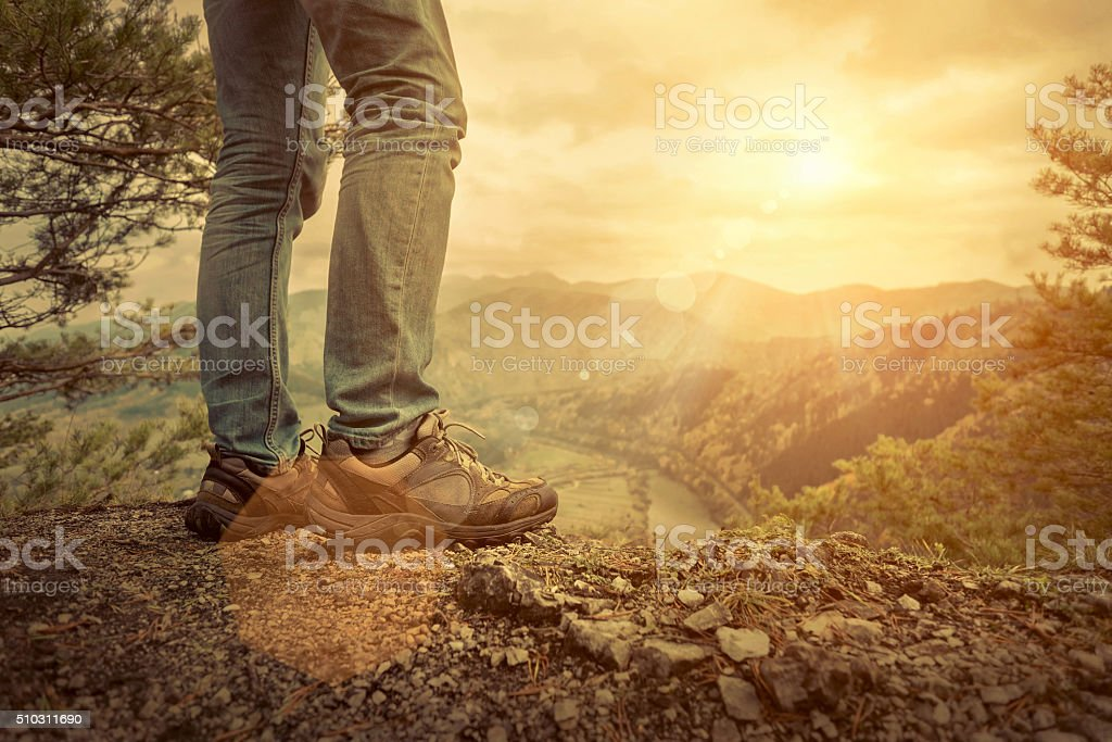 Men stay in Mountains footwear on the beautiful view. stock photo