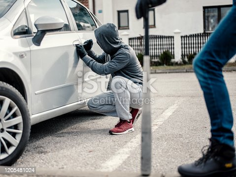 Men stealing a car