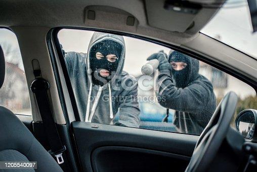 Men stealing a car