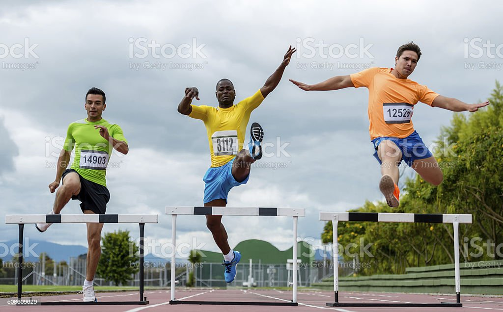 Men steeplechasing stock photo