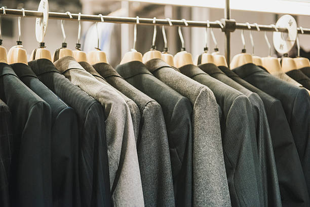 Men suits in a fashion shop in Milan stock photo