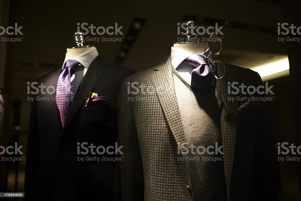 Men suits on display at a store stock photo