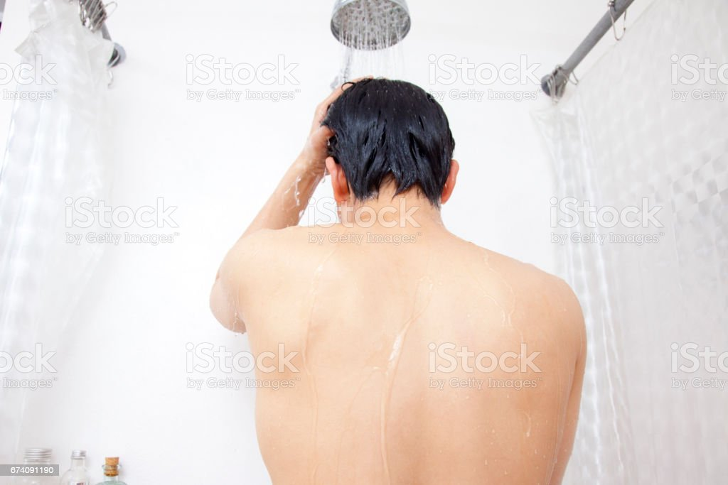 Men taking showers back royalty-free stock photo
