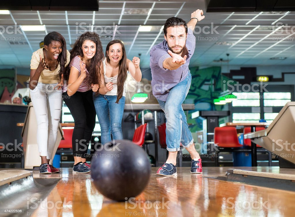 Group of people at Bowling. Men throwing a bowling ball.