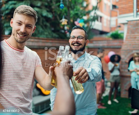 istock Men Toasting At Barbecue Party. 474419312