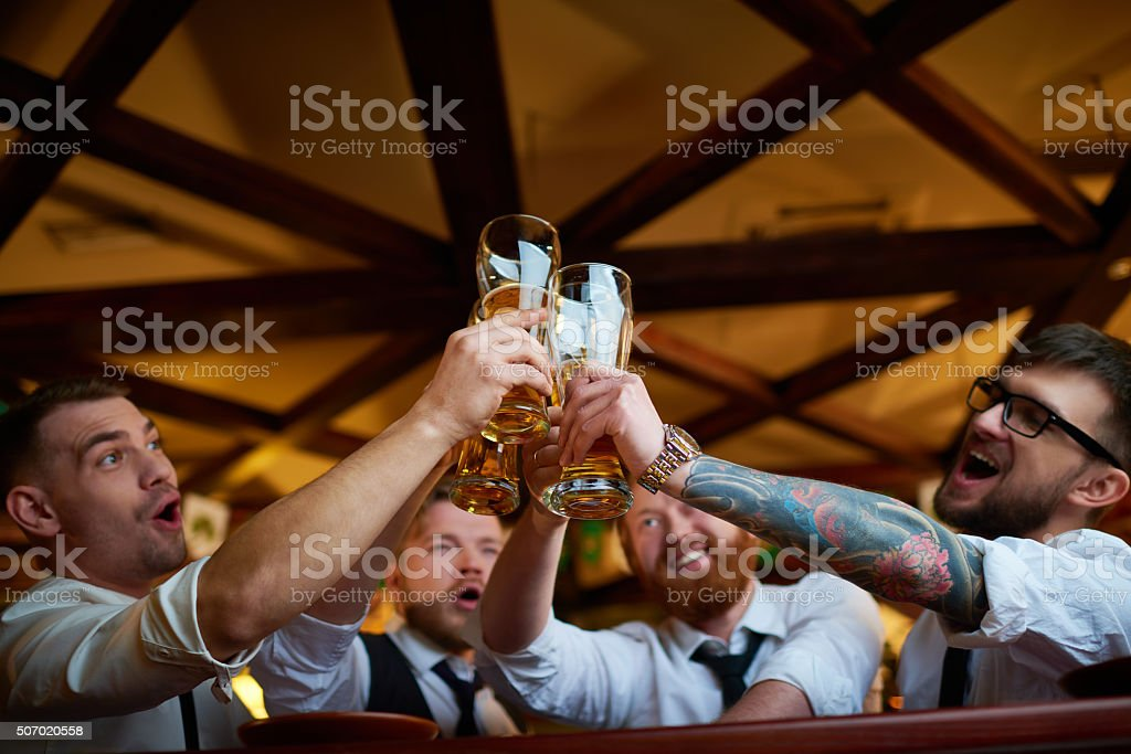 Men toasting stock photo