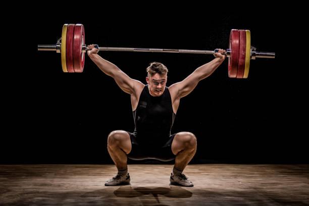 men training with barbells - pesistica foto e immagini stock