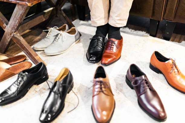 men trying different shoes - men shoes stock pictures, royalty-free photos & images